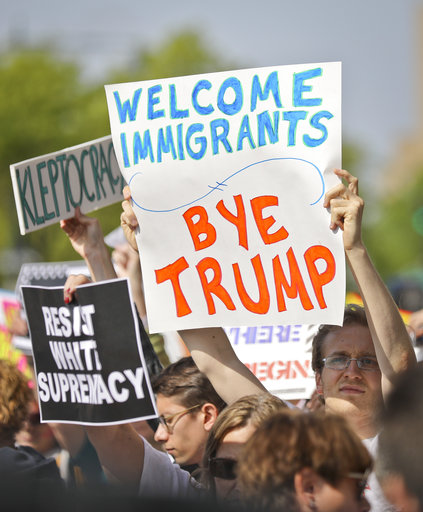 """<div class=""""meta image-caption""""><div class=""""origin-logo origin-image ap""""><span>AP</span></div><span class=""""caption-text"""">Protesters rally near the Intrepid Air and Sea Museum where President Trump is expected to visit, Thursday May 4, 2017, in New York. (AP Photo/Bebeto Matthews)</span></div>"""