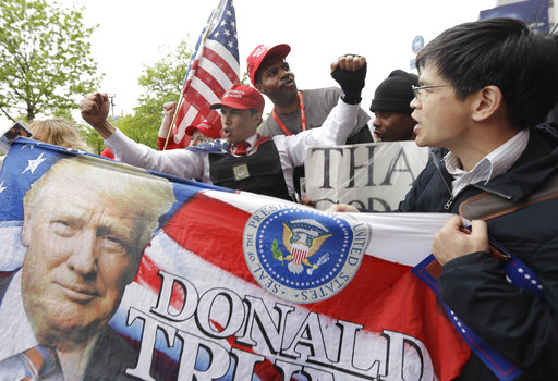"<div class=""meta image-caption""><div class=""origin-logo origin-image ap""><span>AP</span></div><span class=""caption-text"">Supporters of President Donald Trump chant as they gather near the Intrepid, where Trump is expected to attend a Commemorative Dinner on the USS intrepid, Thursday, May 4, 2017. (AP Photo/Julio Cortez)</span></div>"