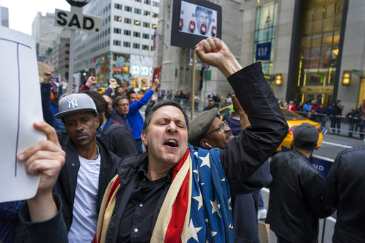 "<div class=""meta image-caption""><div class=""origin-logo origin-image ap""><span>AP</span></div><span class=""caption-text"">Bradley Solomon of New York chants with other protesters gathered near Trump Tower. President Donald Trump is slated to attend an event in New York on Thursday aboard the Intrepid. (AP Photo/Craig Ruttle)</span></div>"