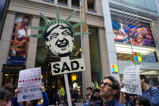 """<div class=""""meta image-caption""""><div class=""""origin-logo origin-image ap""""><span>AP</span></div><span class=""""caption-text"""">Protesters gather near Trump Tower. President Donald Trump is slated to attend an event in New York on Thursday aboard the Intrepid for a Commemorative Dinner on May 4, 2017. (AP Photo/Craig Ruttle)</span></div>"""