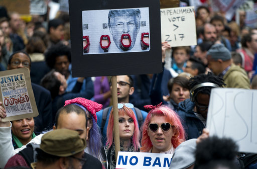 """<div class=""""meta image-caption""""><div class=""""origin-logo origin-image ap""""><span>AP</span></div><span class=""""caption-text"""">Protesters gather near Trump Tower on May 4, 2017. President Donald Trump is slated to attend a Commemorative Dinner in New York on Thursday aboard the Intrepid. (AP Photo/Craig Ruttle)</span></div>"""