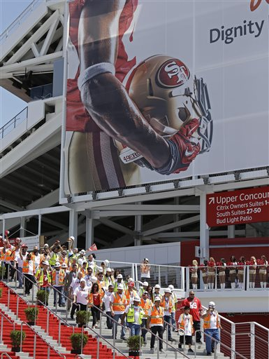 """<div class=""""meta image-caption""""><div class=""""origin-logo origin-image """"><span></span></div><span class=""""caption-text"""">Construction workers make their way to the ribbon-cutting and opening of Levi's Stadium Thursday, July 17, 2014, in Santa Clara, California. (AP Photo/Eric Risberg)</span></div>"""