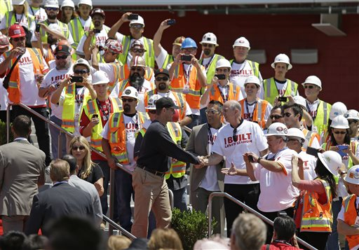 """<div class=""""meta image-caption""""><div class=""""origin-logo origin-image """"><span></span></div><span class=""""caption-text"""">San Francisco 49ers head coach Jim Harbaugh shakes hands with construction workers just before the ribbon-cutting and opening of Levi's Stadium. (AP Photo/Eric Risberg)</span></div>"""