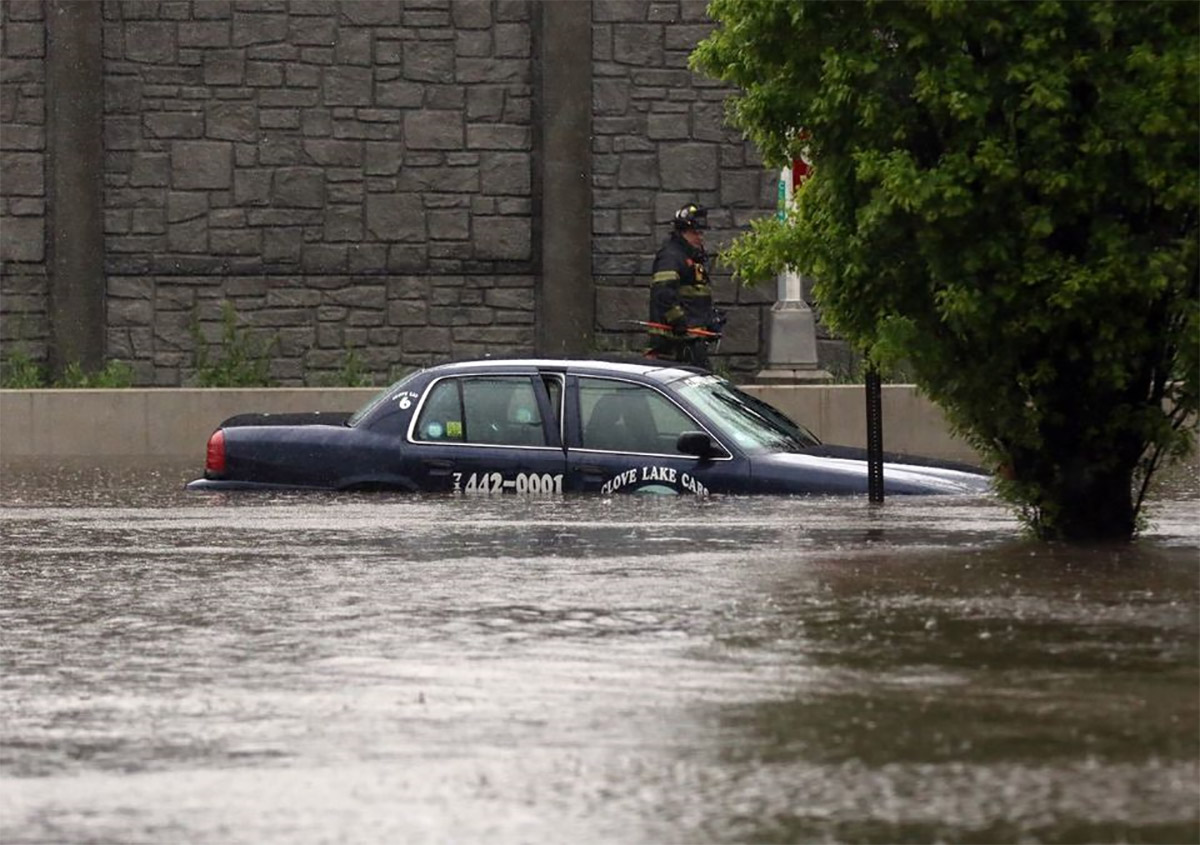 <div class='meta'><div class='origin-logo' data-origin='none'></div><span class='caption-text' data-credit='Photo: Staten Island Advance/Jan Somma-Hammel'>FDNY saves a cab driver as he misjudged the water level and remains stuck at Sheraden Avenue and South Gannon Avenue.</span></div>
