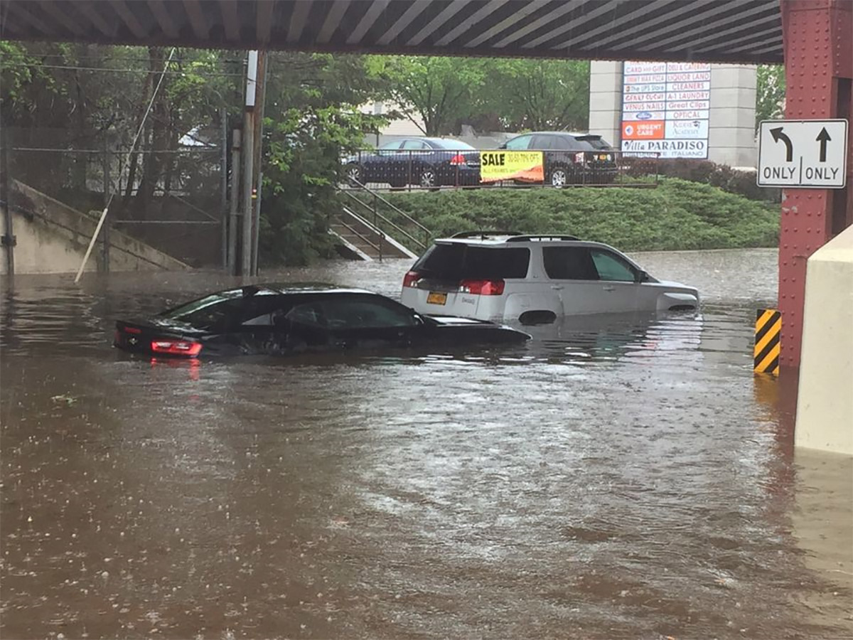 <div class='meta'><div class='origin-logo' data-origin='none'></div><span class='caption-text' data-credit='Photo: Staten Island Advance/Erik Bascome'>Two cars are stuck on Amboy Road under the Staten Island Railway overpass in Bay Terrace on Friday, May 5, 2017.</span></div>