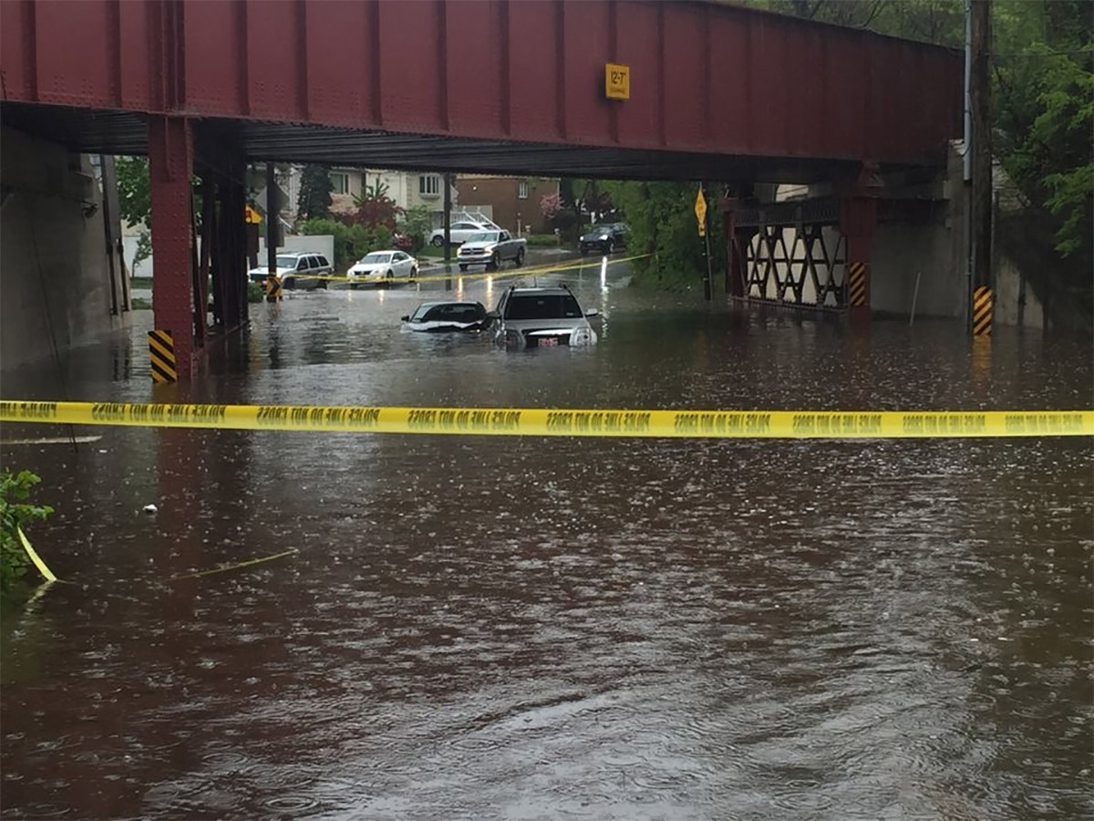 <div class='meta'><div class='origin-logo' data-origin='none'></div><span class='caption-text' data-credit='Photo: Staten Island Advance/Irene Spezzamonte'>Flood waters cause the closure of Amboy Road under the Staten Island Railway overpass in Bay Terrace on Friday, May 5, 2017.</span></div>