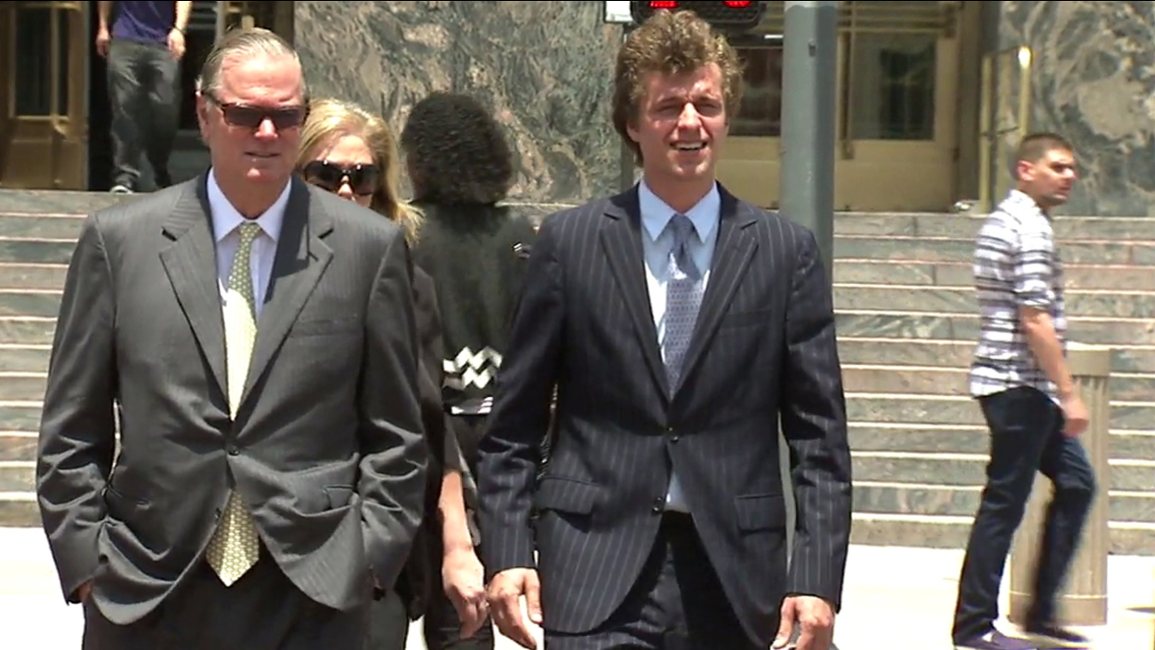 Conrad Hilton, right, is seen after a court appearance in an undated file photo.