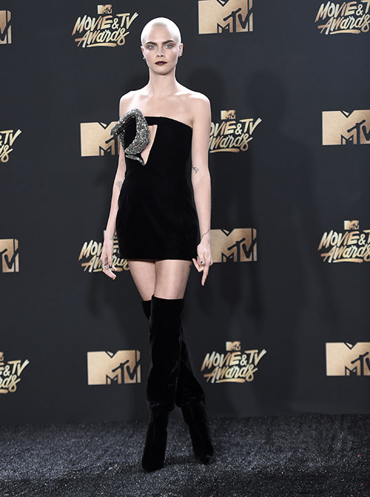"<div class=""meta image-caption""><div class=""origin-logo origin-image none""><span>none</span></div><span class=""caption-text"">Cara Delevingne arrives at the MTV Movie and TV Awards at the Shrine Auditorium on Sunday, May 7, 2017, in Los Angeles. (Richard Shotwell/Invision/AP)</span></div>"