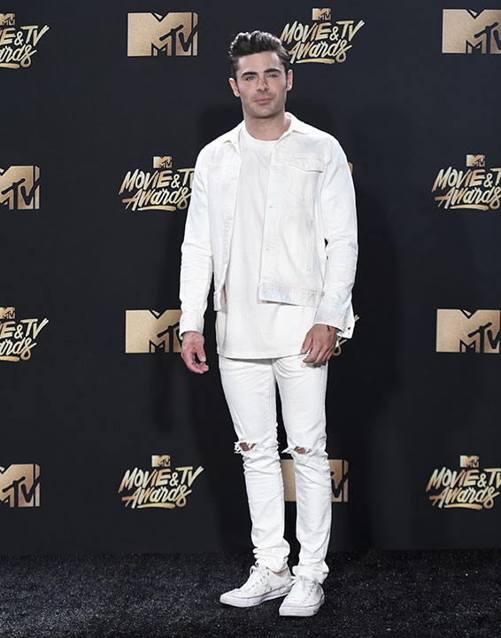 "<div class=""meta image-caption""><div class=""origin-logo origin-image none""><span>none</span></div><span class=""caption-text"">Zac Efron poses in the press room at the MTV Movie and TV Awards at the Shrine Auditorium on Sunday, May 7, 2017, in Los Angeles. (Richard Shotwell/Invision/AP)</span></div>"