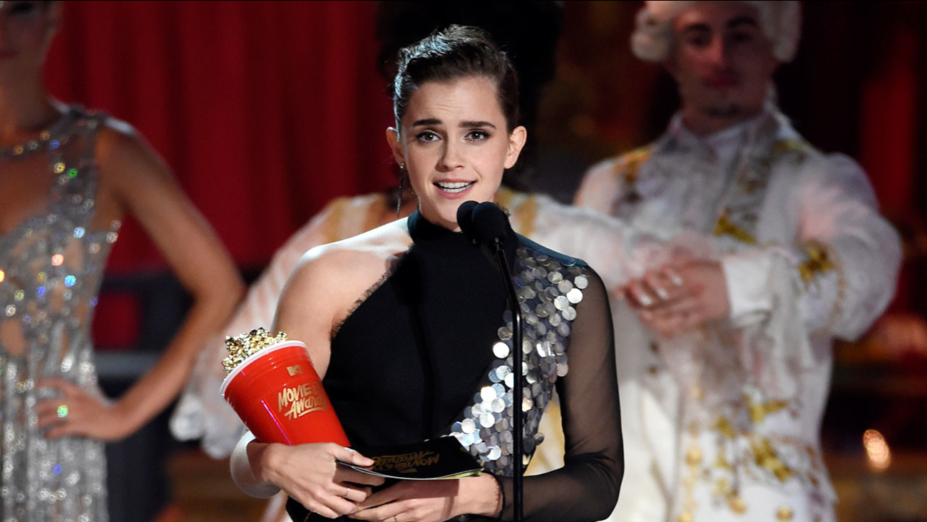 """Emma Watson accepts the award for best actor in a movie for """"Beauty and the Beast"""" at the MTV Movie and TV Awards at the Shrine Auditorium on Sunday, May 7, 2017."""
