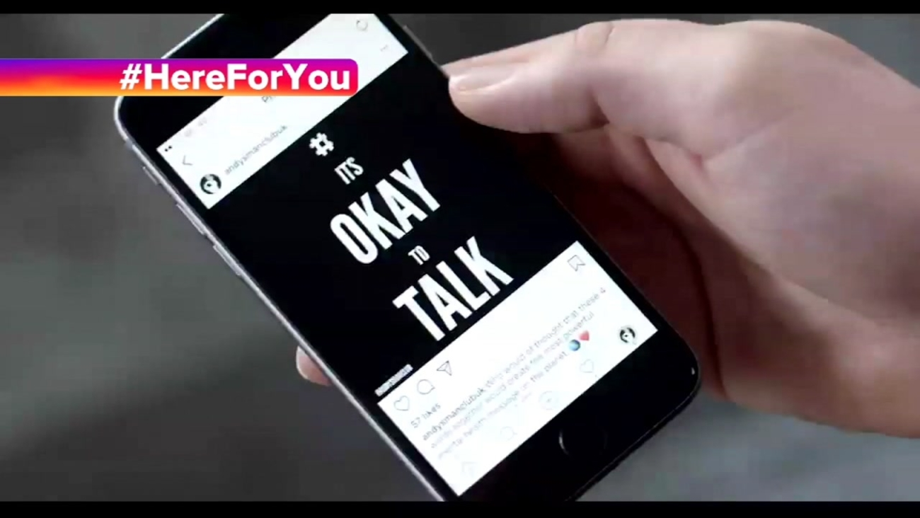 A user scrolls through Instagram in the social media giant's #HereForYou campaign video.