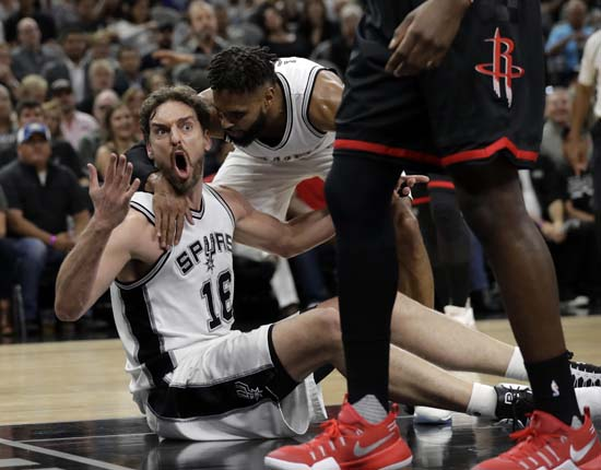 """<div class=""""meta image-caption""""><div class=""""origin-logo origin-image ap""""><span>AP</span></div><span class=""""caption-text"""">San Antonio Spurs' Pau Gasol (16) of Spain reacts to an officials call as Patty Mills (8) talks with him thduring the first half of Game 5. (AP Photo/Eric Gay) (AP)</span></div>"""