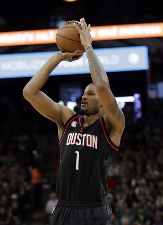 """<div class=""""meta image-caption""""><div class=""""origin-logo origin-image ap""""><span>AP</span></div><span class=""""caption-text"""">Houston Rockets forward Trevor Ariza (1) attempts a shot during the first half in Game 5. (AP Photo/Eric Gay) (AP)</span></div>"""