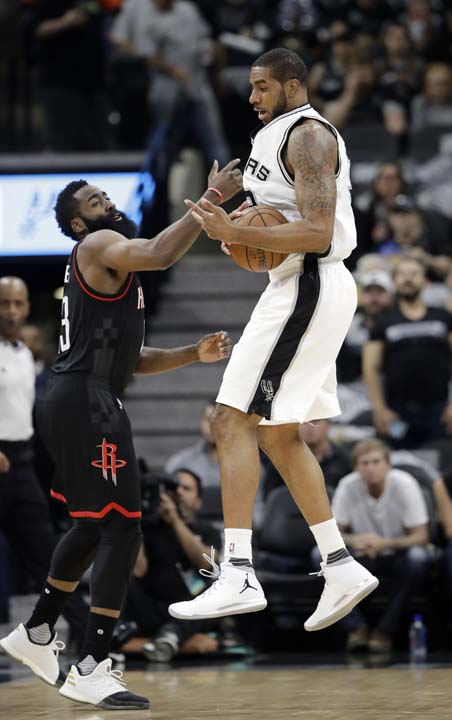 """<div class=""""meta image-caption""""><div class=""""origin-logo origin-image ap""""><span>AP</span></div><span class=""""caption-text"""">Houston Rockets' James Harden (13) causes San Antonio Spurs' LaMarcus Aldridge (12) to lose control of the ball during the first half in Game 5. (AP Photo/Eric Gay) (AP)</span></div>"""