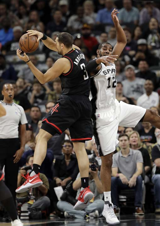 """<div class=""""meta image-caption""""><div class=""""origin-logo origin-image ap""""><span>AP</span></div><span class=""""caption-text"""">Houston Rockets' Ryan Anderson (3) collects an defensive rebound in front of San Antonio Spurs' LaMarcus Aldridge (12) during the first half in Game 5. (AP Photo/Eric Gay) (AP)</span></div>"""