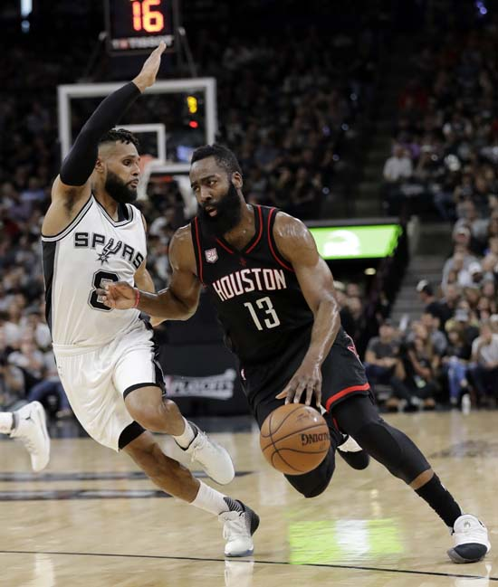 """<div class=""""meta image-caption""""><div class=""""origin-logo origin-image ap""""><span>AP</span></div><span class=""""caption-text"""">San Antonio Spurs' Patty Mills (8) defends as Houston Rockets guard James Harden (13) advances the ball up court during the first half of Game 5. (AP Photo/Eric Gay) (AP)</span></div>"""