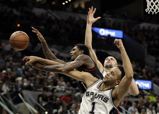 """<div class=""""meta image-caption""""><div class=""""origin-logo origin-image ap""""><span>AP</span></div><span class=""""caption-text"""">Houston Rockets guard Lou Williams (12) loses control of the ball on a shot attempt as San Antonio Spurs' Kyle Anderson (1) and Manu Ginobili, rear. (AP Photo/Eric Gay) (AP)</span></div>"""