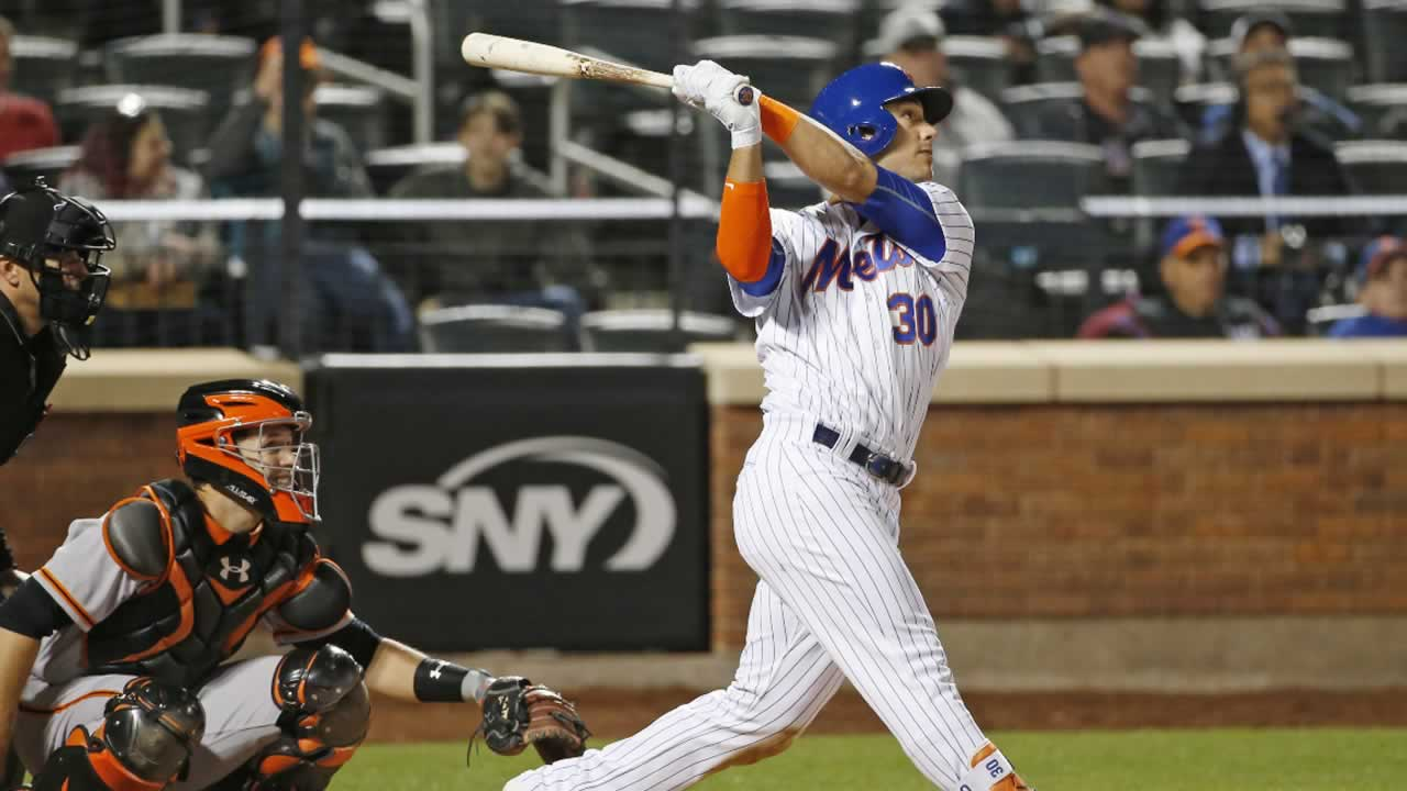 New York Mets' Michael Conforto follows through on a seventh-inning solo home run during a baseball game against the San Francisco Giants, Tuesday, May 9, 2017, in New York.