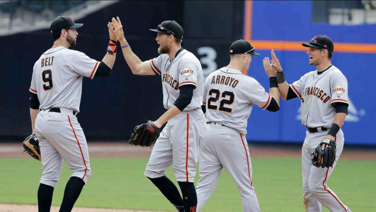 San Francisco Giants' Brandon Belt (9), Hunter Pence, Christian Arroyo (22) and Joe Panik, right, celebrate after a baseball game against the New York Mets, Wednesday, May 10, 2017