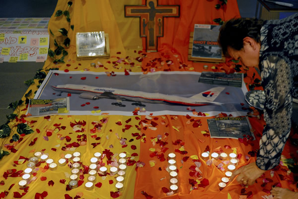 """<div class=""""meta image-caption""""><div class=""""origin-logo origin-image """"><span></span></div><span class=""""caption-text"""">Candles are placed for a prayer for victims of the Malaysia Airlines Flight 17 at a church outside Kuala Lumpur, Malaysia, Friday, July 18, 2014 (AP Photo/Joshua Paul)</span></div>"""