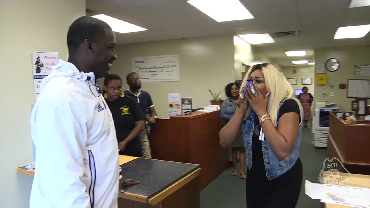 ECU football coach surprised a player's mother with a full scholarship