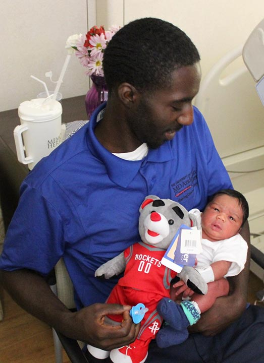 "<div class=""meta image-caption""><div class=""origin-logo origin-image none""><span>none</span></div><span class=""caption-text"">Rockets have an extra special cheering section in the Children's Memorial Hermann Hospital labor and delivery unit!</span></div>"