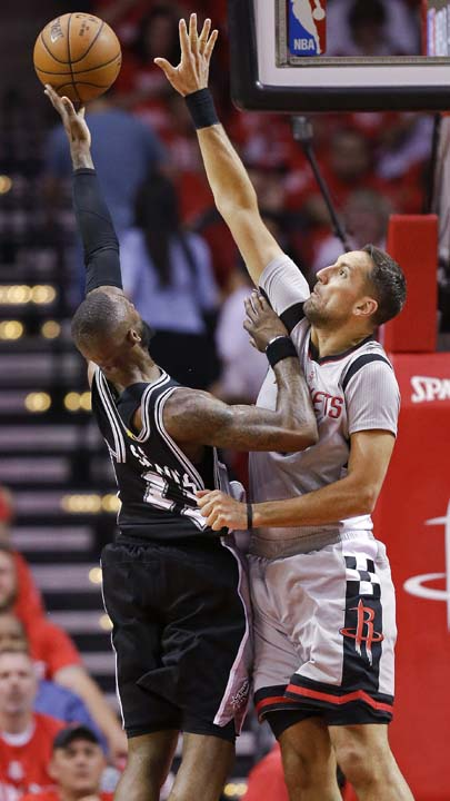 <div class='meta'><div class='origin-logo' data-origin='KTRK'></div><span class='caption-text' data-credit='AP'>San Antonio Spurs guard Jonathon Simmons, left, shoots as Houston Rockets forward Ryan Anderson defends during the first half in Game 6. (AP Photo/Eric Christian Smith)</span></div>