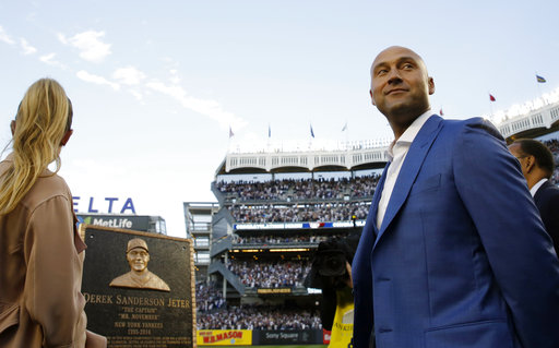 <div class='meta'><div class='origin-logo' data-origin='AP'></div><span class='caption-text' data-credit='AP'>Retired Yankees shortstop Derek Jeter, right, looks around during a pregame ceremony after his No. 2 was retired in Monument Park at Yankee Stadium May 14, 2017 (Kathy Willens)</span></div>