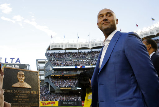<div class='meta'><div class='origin-logo' data-origin='AP'></div><span class='caption-text' data-credit='AP'>Retired Yankees shortstop Derek Jeter, right, looks around during a pregame ceremony after his No. 2 was retired in Monument Park at Yankee Stadium May 14, 2017. (Kathy Willens)</span></div>