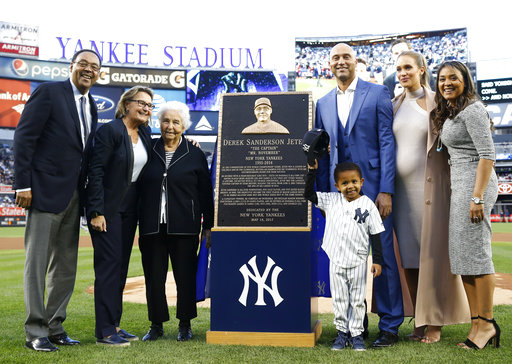<div class='meta'><div class='origin-logo' data-origin='AP'></div><span class='caption-text' data-credit='AP'>Retired New York Yankees shortstop Derek Jeter third from right, poses with members of his family  (AP Photo/Kathy Willens, Pool)</span></div>