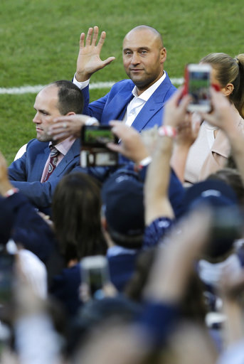 <div class='meta'><div class='origin-logo' data-origin='AP'></div><span class='caption-text' data-credit='AP'>Former New York Yankees' Derek Jeter waves to fans during a ceremony retiring his number at Yankee Stadium, Sunday, May 14, 2017, in New York. (AP Photo/Seth Wenig)</span></div>