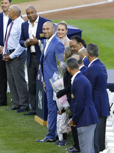 <div class='meta'><div class='origin-logo' data-origin='AP'></div><span class='caption-text' data-credit='AP'>Former New York Yankees' Derek Jeter, center, smiles during a ceremony retiring his number at Yankee Stadium, Sunday, May 14, 2017, in New York. (AP Photo/Seth Wenig)</span></div>