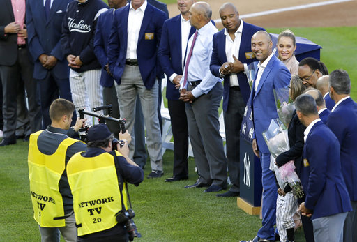 <div class='meta'><div class='origin-logo' data-origin='AP'></div><span class='caption-text' data-credit='AP'>Former New York Yankees' Derek Jeter, right, participates in a ceremony retiring his number at Yankee Stadium, Sunday, May 14, 2017, in New York. (AP Photo/Seth Wenig)</span></div>