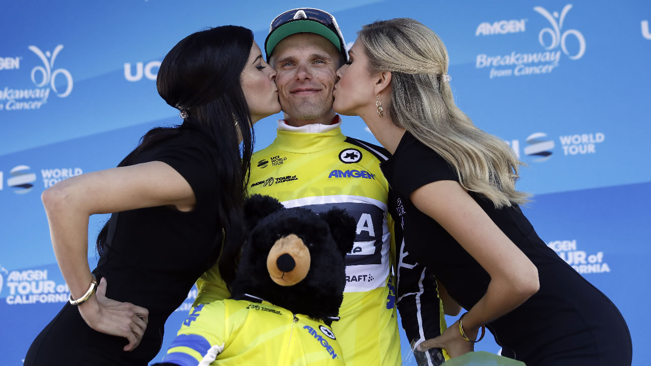 Rafal Majka, center, of Poland, gets kisses on the podium after winning Stage 2 of the Tour of California cycling race Monday, May 15, 2017, in San Jose, Calif.