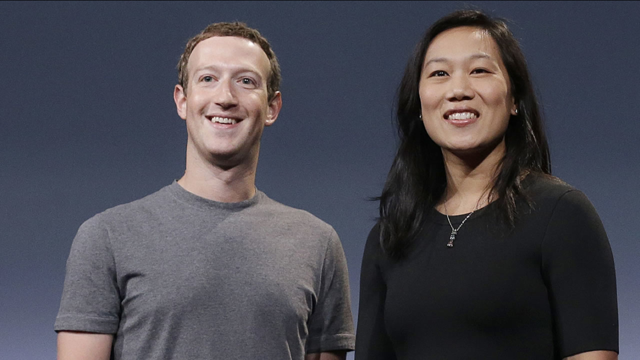 In this Tuesday, Sept. 20, 2016, photo, Facebook CEO Mark Zuckerberg and his wife, Priscilla Chan, smile as they prepare for a speech in San Francisco.