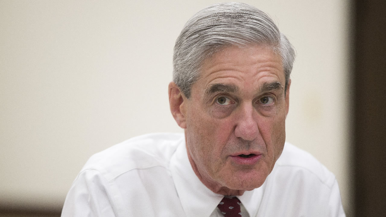 Outgoing FBI director Robert Mueller speaks during an interview at FBI headquarters on Wednesday, Aug. 21, 2013, in Washington.