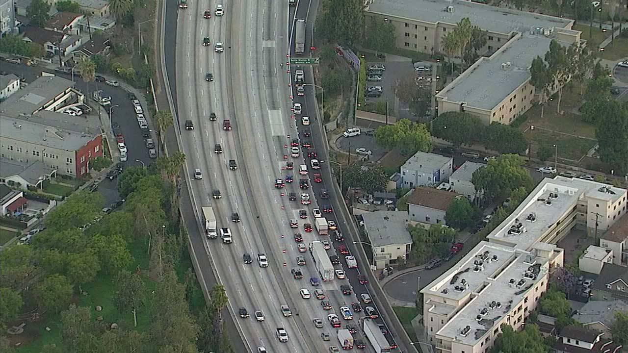 Cars are directed off the 101 Freeway following a closure near Western Avenue in Hollywood on Thursday, May 18, 2017.