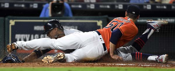 "<div class=""meta image-caption""><div class=""origin-logo origin-image ap""><span>AP</span></div><span class=""caption-text"">Francisco Lindor, left, is tagged out by Houston Astros starting pitcher Charlie Morton during the fifth inning of a baseball game (AP Photo/Eric Christian Smith) (AP)</span></div>"