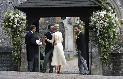 "<div class=""meta image-caption""><div class=""origin-logo origin-image none""><span>none</span></div><span class=""caption-text"">Spencer Matthews, second left, is greeted by Donna Air as James Middleton, right, looks on ahead of the wedding of Pippa Middleton and James Matthews, Saturday, May 20, 2017. (AP)</span></div>"