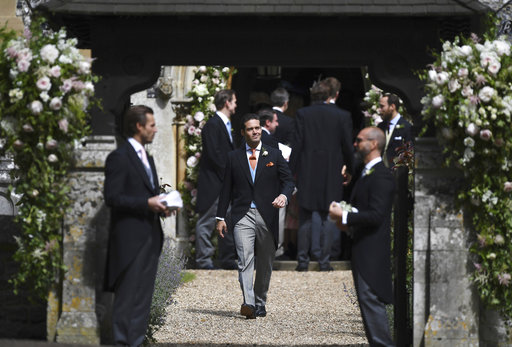 "<div class=""meta image-caption""><div class=""origin-logo origin-image none""><span>none</span></div><span class=""caption-text"">Spencer Matthews, centre, brother of the groom, stands at the entrance of the church ahead of the wedding of Pippa Middleton and James Matthews, Saturday, May 20, 2017. (AP)</span></div>"
