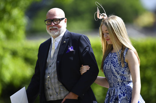 "<div class=""meta image-caption""><div class=""origin-logo origin-image none""><span>none</span></div><span class=""caption-text"">Gary Goldsmith, left, uncle of the bride and his daughter Tallulah, arrive for the wedding of Pippa Middleton and James Matthews, Saturday, May 20, 2017. (AP)</span></div>"