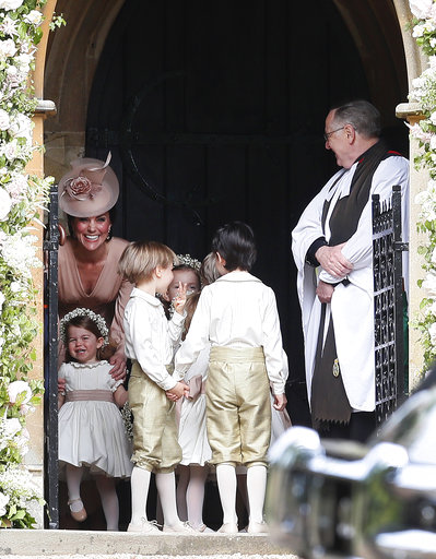 "<div class=""meta image-caption""><div class=""origin-logo origin-image none""><span>none</span></div><span class=""caption-text"">Kate, Duchess of Cambridge, left, stands with her daughter Princess Charlotteas they arrive for the wedding of Pippa Middleton and James Matthews Saturday, May 20, 2017. (AP)</span></div>"