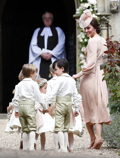 "<div class=""meta image-caption""><div class=""origin-logo origin-image none""><span>none</span></div><span class=""caption-text"">Kate, Duchess of Cambridge, right, arrives with the pageboys and flower girls for the wedding of Pippa Middleton and James Matthews, Saturday, May 20, 2017. (AP)</span></div>"