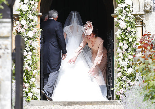 "<div class=""meta image-caption""><div class=""origin-logo origin-image none""><span>none</span></div><span class=""caption-text"">Kate, Duchess of Cambridge, right, arranges the train of her sister of her sister Pippa Middleton. (AP)</span></div>"