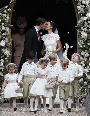 <div class='meta'><div class='origin-logo' data-origin='AP'></div><span class='caption-text' data-credit='AP'>Pippa Middleton and James Matthews kiss after their wedding at St Mark's Church (AP Photo/Kirsty Wigglesworth, Pool)</span></div>