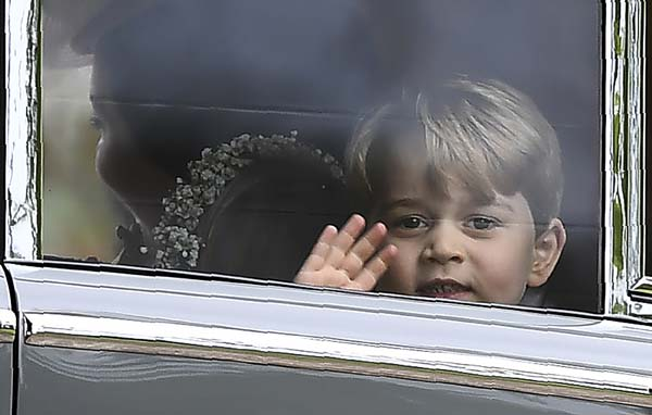 <div class='meta'><div class='origin-logo' data-origin='AP'></div><span class='caption-text' data-credit='AP'>Britain's Prince George waves as he leaves in a car after attending the wedding of his aunt, Pippa Middleton to James Matthews (Justin Tallis/Pool Photo via AP)</span></div>