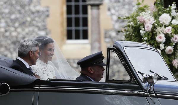 <div class='meta'><div class='origin-logo' data-origin='AP'></div><span class='caption-text' data-credit='AP'>Pippa Middleton arrives with her father Michael Middleton for her wedding to James Matthews at St Mark's Church (AP Photo/Kirsty Wigglesworth, Pool)</span></div>