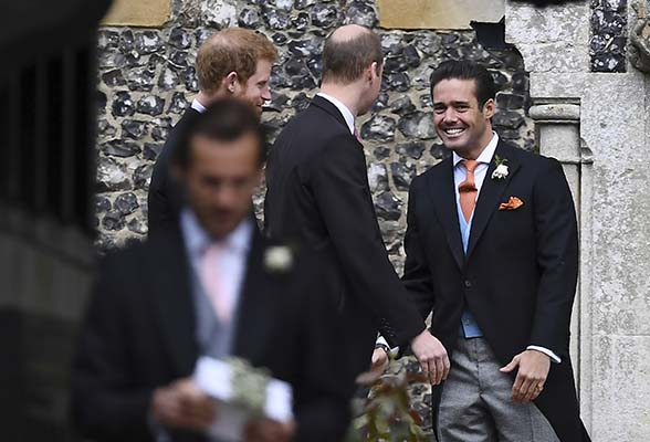 <div class='meta'><div class='origin-logo' data-origin='AP'></div><span class='caption-text' data-credit='AP'>Spencer Matthews talks with Britain's Prince William, and Prince Harry, left as they arrive for the wedding of Pippa Middleton and James Matthews (Justin Tallis/Pool Photo via AP)</span></div>