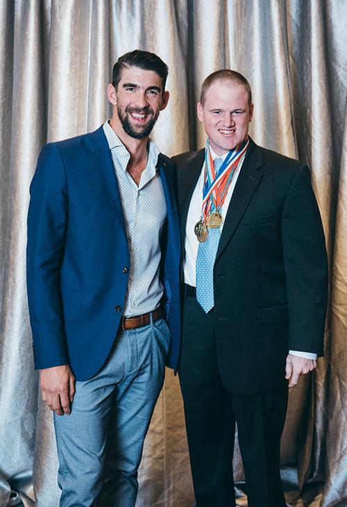 <div class='meta'><div class='origin-logo' data-origin='KTRK'></div><span class='caption-text' data-credit='Allen S. Kramer/Texas Children's Hospital.'>Michael Phelps and Frank Tucker who is proudly wearing his Special Olympics medals</span></div>