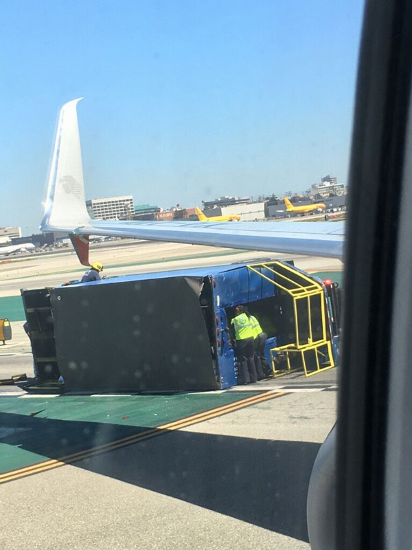 A passenger onboard the Aeromexico flight captured an image of the overturned utility truck and damaged wing.